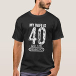 "Mens 40th Birthday T Shirt - My Wife Is 40 And Sti<br><div class=""desc"">Get one of these low pricing T-shirts now! The prices can rise up any time. Also have a look at our other Shirts by clicking on the Brand name above! Looking for a birthday present for your awesome wife? Looking for a birthday present for your awesome wife? This funny, vintage...</div>"