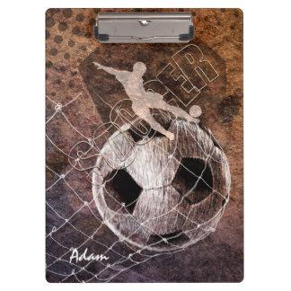 Men's soccer player kicking for goal clipboard