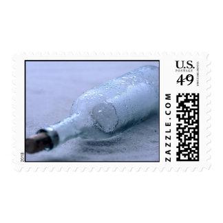 Mensaje en la arena timbre postal