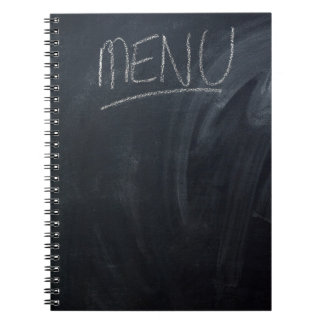 Menu written on a chalk board with space for text notebook