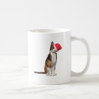 Meowy Christmas with a playful cat in a hat Coffee Mug