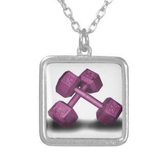Mercancía rosada de las pesas de gimnasia joyerías