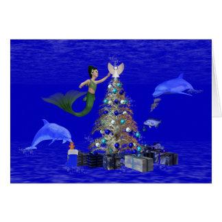 Mermaid decorating the christmas tree card