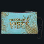"Mermaid Vibes- Gold Glitter Typography on Teal Wristlet<br><div class=""desc"">This pretty sparkling aqua blue, gold and teal turquoise Mermaid Glitter Saying &quot;Mermaid Vibes&quot; design is for all Luxury Fashion Lovers. I created it with different glitter styles and textures and metal foil layers. A beautiful fresh blue, pink gold and aqua turquoise Design. It is the perfect gift for her...</div>"