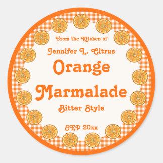 Mermelada anaranjada en la guinga pegatina redonda