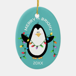 Merry and Bright Christmas Penguin Fun Blue Oval Ceramic Ornament