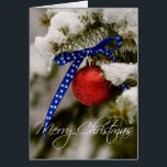 """Merry Christmas Patriotic Christmas Card<br><div class=""""desc"""">Show your patriotic spirit! A red Christmas ornament with a blue and white ribbon hangs on a snowy pine tree. Totally customizable for you to personalize as you please!</div>"""