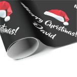 "Merry Christmas Santa Hat wrapping paper<br><div class=""desc"">Merry Christmas Santa Hat wrapping paper. Customize Name or Wordings. Perfect for Christmas or Holiday gift-wrapping and crafting. For further customization,  please click the ""Customize it"" button and use our design tool to modify this template.</div>"