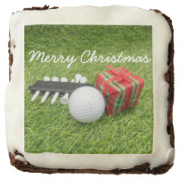 Merry Christmas with golf ball and gift on green Brownie
