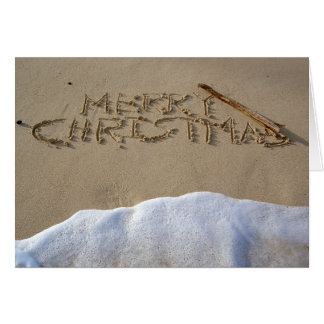 Merry Christmas written on the beach Greeting Card