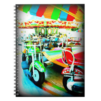 Merry Go Round Motor bikes at the Carnival Notebook