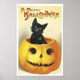 Merry Halloween Cat in Pumpkin Posters