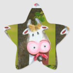 merry, painted cow from wood,