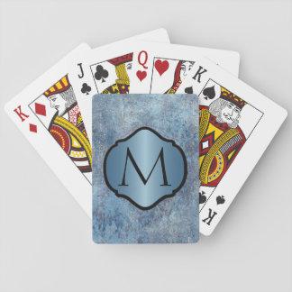 Metal azul sucio fotorrealista con monograma barajas de cartas