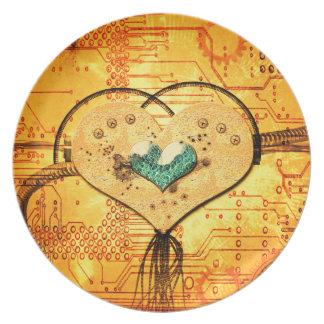 Metal el corazón con los tubos, los conductos y platos