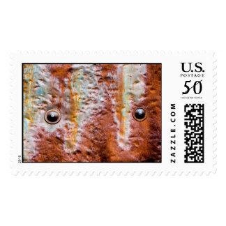 metal eyes rust postage