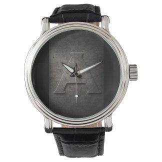 Metal negro rústico un reloj del monograma