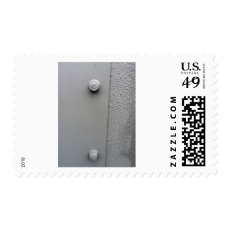 Metal Plate Bolted To Wall Postage