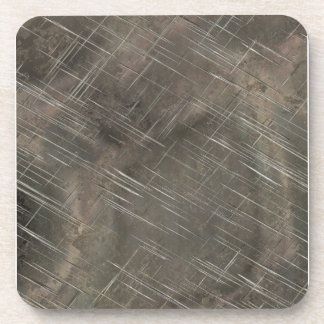 Metal plateado rasguñado posavasos