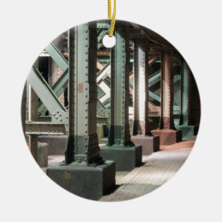 Metal rivetted struts below a bridge ceramic ornament