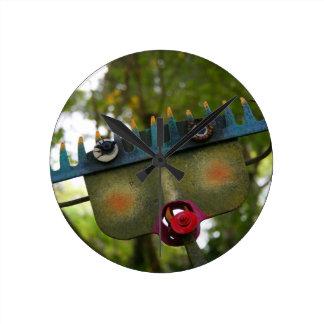 metal sculpture garden face on rake neat design round clock