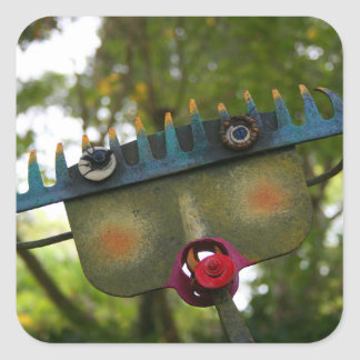 metal sculpture garden face on rake neat design sticker