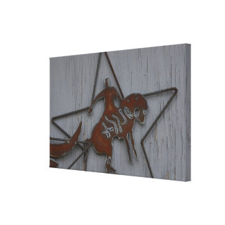 Metal sculpture of cowboy on bucking bronco canvas print