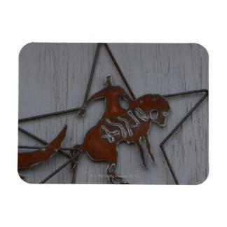 Metal sculpture of cowboy on bucking bronco magnet