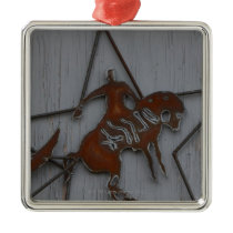 Metal sculpture of cowboy on bucking bronco metal ornament