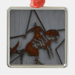 Metal sculpture of cowboy on bucking bronco ornaments