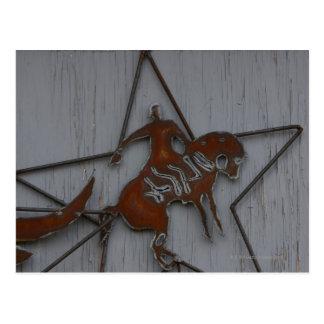 Metal sculpture of cowboy on bucking bronco postcards