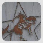 Metal sculpture of cowboy on bucking bronco stickers