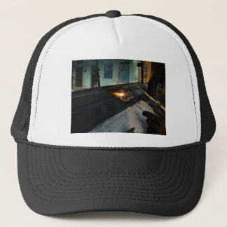 Metal Themed, A Man Carefully Welds A Large, Metal Trucker Hat