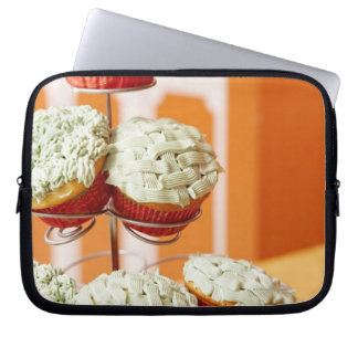 Metal tree displaying frosted cupcakes computer sleeve
