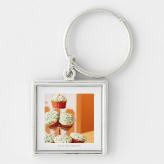 Metal tree displaying frosted cupcakes keychain