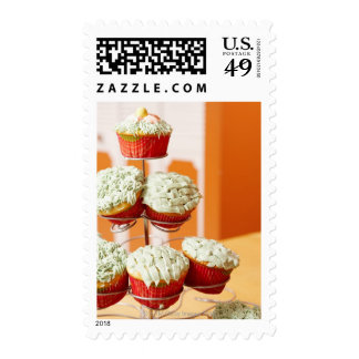Metal tree displaying frosted cupcakes postage