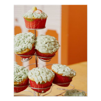 Metal tree displaying frosted cupcakes poster