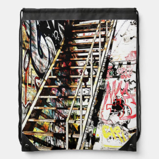 metal urban staircase with graffiti backpack
