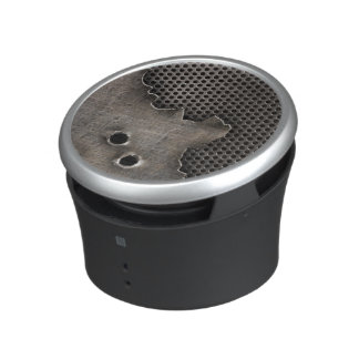 Metal with bullet holes background speaker