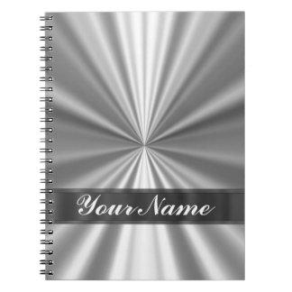 Metallic looking silver spiral notebook