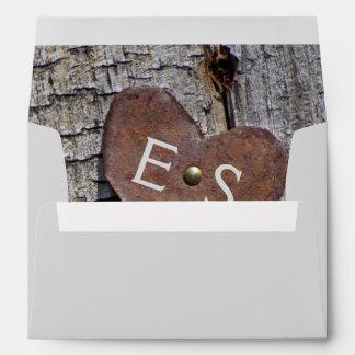 Metallic rusted heart, monogram on wood wedding envelope