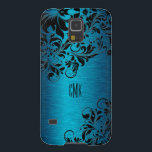 "Metallic Turquoise With Black Floral Swirls Galaxy S5 Case<br><div class=""desc"">Metallic turquoise background brushed aluminum look with black floral swirls lace. Customizable monogram.  Several version on this design with different lace position. If you need any help customizing,  changing color,  or anything else to any of my designs,  contact ArtOnWear designer. Free text formatting with live help available by request.</div>"