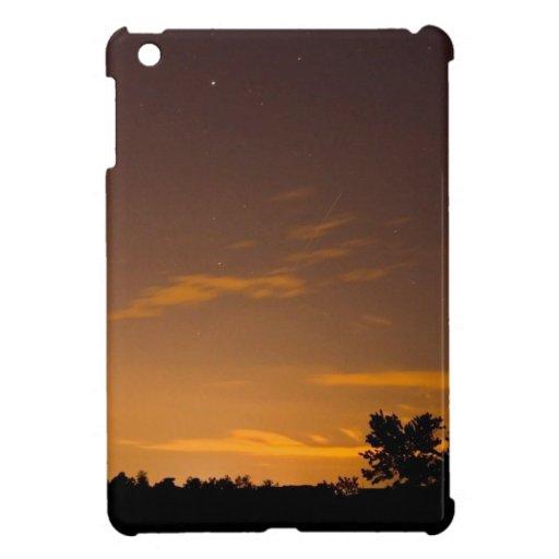 Meteorito en la puesta del sol iPad mini cárcasas