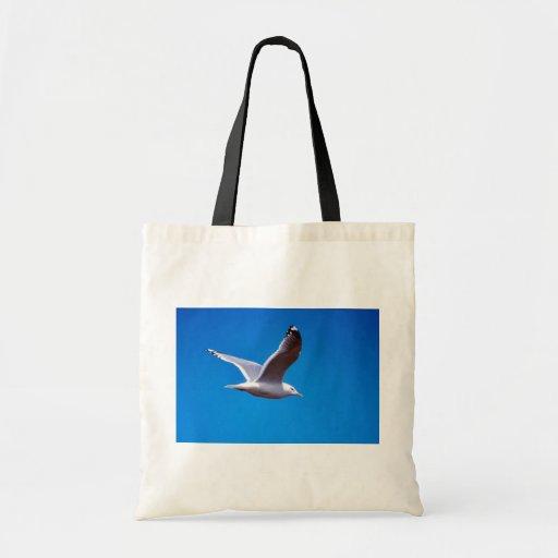 Mew Gull in Flight Tote Bags