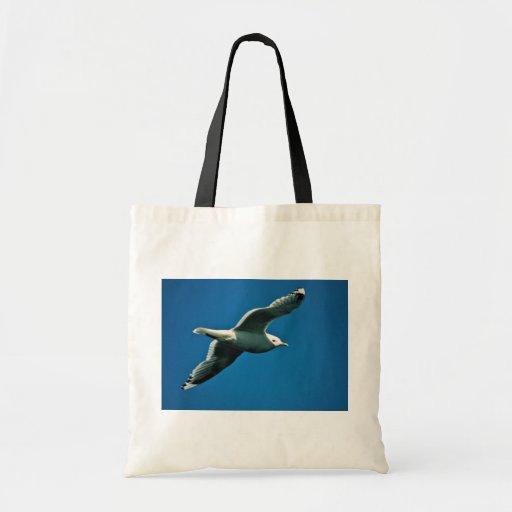 Mew Gull in Flight over Frazer Lake Canvas Bags