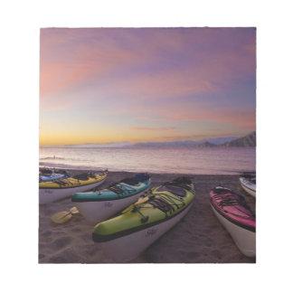 Mexico, Baja, Sea of Cortez. Sea kayaks and Notepad