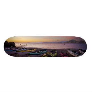 Mexico, Baja, Sea of Cortez. Sea kayaks and Skateboard