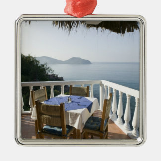Mexico, Guerrero, Zihuatanejo. Cafe Table over Metal Ornament