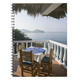 Mexico, Guerrero, Zihuatanejo. Cafe Table over Notebook