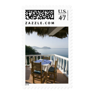 Mexico, Guerrero, Zihuatanejo. Cafe Table over Postage